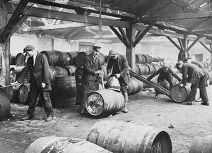 Customs workers at a bonded warehouse in London, England. undated