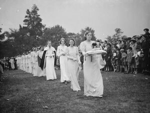 The Dartford Carnival Queen with her attendees arriving for the queens coronation. 1938