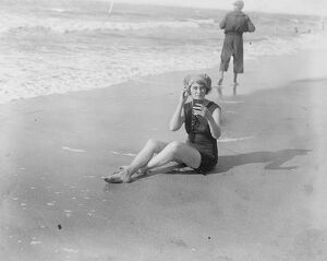 The Deauville Season. Lady Pedler completing her seaside toilet at Deauville 10