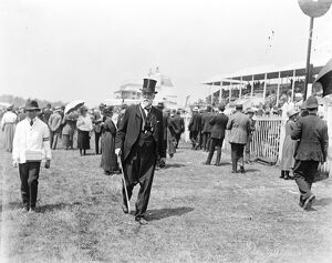 Derby day at Epsom Lord D ' Abernon walking on the course 31 May 1922