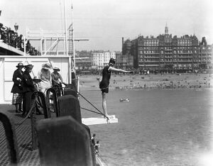 Diving off the pier during the Whitsun holiday at Brighton. 1920