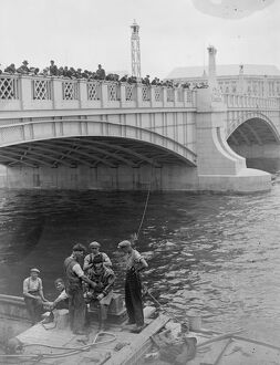 Diving in the Thames . A large crowd watched a diver Mr W R Gloss descend to the