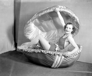 Easter, 1936. 'Dawn the famous Selfridge model and an outsize Easter egg