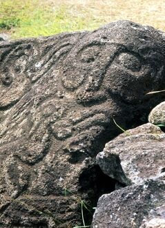 Easter Island - Orongo petroglyphs, including a humanoid face, on the sacred rocks
