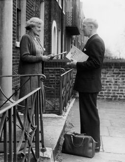An enumerator seen collecting Census papers when on his rounds in Kennington, London