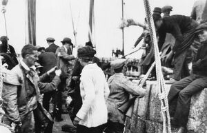 Erskine Childers (in oilskins) as arms landed from the 'Asgard' at Howth