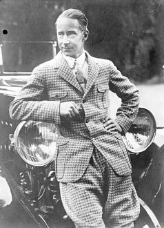 Ex-Crown Prince Wilhelm of Germany leaning on a car in his holiday suit. [son of