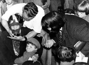 Fitting gas masks to children at Lambeth Town Hall 1939 History of London - Vauxhall