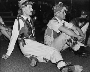 Folk Dance Festival. Lads from the country take a breather: their costumes are adorned
