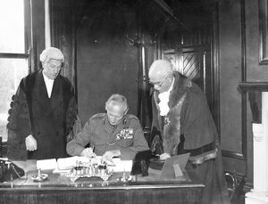 Freedom of Hastings for Montgomery. Viscount Montgomery of Alamein signing the visitors