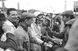 Friends and fans gather round to congratulate John Surtees after he won the German