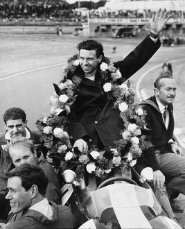 'Garlanded Jim Clark'. Draped in the victory garland, World Champion Jim