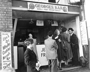 George's Bar Shell Fish Fresh Daily A queue of people wait to be served but a woman