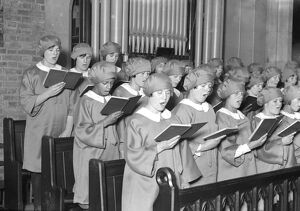 Girl choristers at Dr Barnardo's homes, Berkingside, practising christmas carols