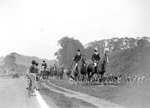 Girl cyclists watch the Royal Artillery (RA) drag hunt at Green St Green, Kent. 1934