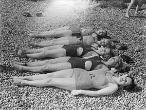 Girls lying on the beach in the sunshine. 25 May 1937 [?]
