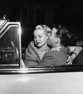 Glamorous American actress , Joi Lansing in a romantic embrace with her boyfriend