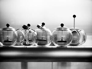 Glass Bodum teapots on metal shelf in restaurant credit: Marie-Louise Avery /