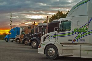 A great selection of trucks parked up at dusk on a Ontario service station SW of