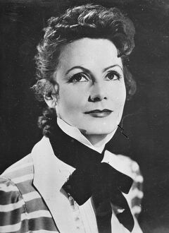 Greta Garbo's new hairstyle, in which curls have taken the place of the almost severe