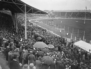 Greyhound race meeting at the White City. A portion of the crowd watching the parade