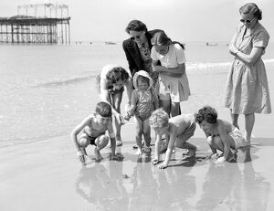 Happy holidaymakers at St Leonards - On - Sea, Hastings, East Sussex