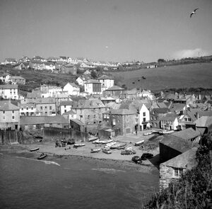 Harbour with boats at Port Isaacs , Cornwall , England , UK 1960 ' s Fish where
