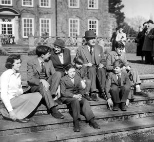 Harold MacMillan and his wife Lady Dorothy with their grandchildren on the steps