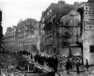 Home front 1940. Showing the destruction caused by German bombing, Brits go about