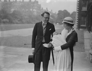 The Hon Lancelot and Mrs Joynson Hicks and their infant son after his christening