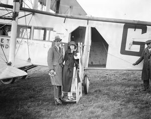 The honeymoon express. Pilot Officer Whinney, RAF, who married Miss Edna Moodie