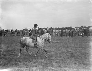 A horse show in Westerham, Kent. Young girl riding a pony. 1936