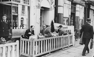 A hot summer's day revelas al fresco dining in West End London, England. 15 May 1947