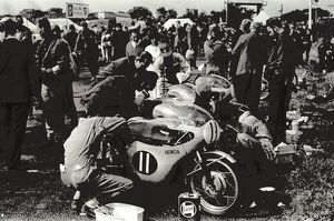 Isle of Man: Mechanics at work in the pits ofn the Japanese honda machines before