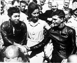 Jim Redman (right), shakes hands with Japan's Fumio Ito after winning the 250 cc