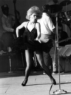 Joey Heatherton, entertains American servicemen with a torrid dance during the troops