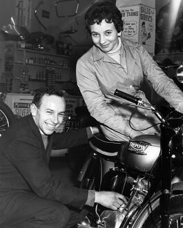 John and Dorothy Surtees in their family motorcycle shop 1950s