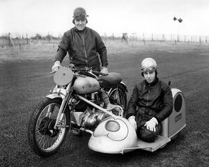 John ( in the sidecar ) and his father, Jack Surtees at a race meeting