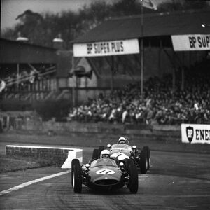 John Surtees 11 and Stirling Moss 7 racing in the Goodwood International 100 for