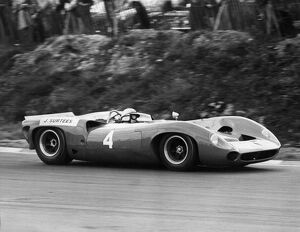 John Surtees No 4, driving a Lola 70 Chevrolet. He won both heats of the Guards