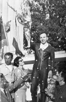 John Surtees acknowledges the cheers of the crowd after his second victory at Monza Italy