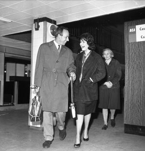 John Surtees arrives into London Airport to meet Patricia Burke his Fiancee 6 February