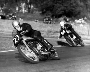 John Surtees compact crouch helps to streamline him at top speed. Here he corners