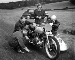 John Surtees and his family and friends get down to some motorbike maintenance at