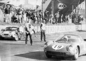 John Surtees in his Ferarri leading after 33 laps flashing past Mike Rothschild's