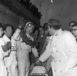 John Surtees garlanded and cheered after his victory in the XIII Grand Prix Siracusa