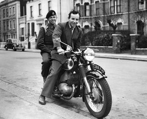 John Surtees, international motor cyclist from Forest Hill, London, was approached