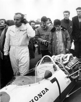 John Surtees leaving his honda after retiring with engine trouble during the Race