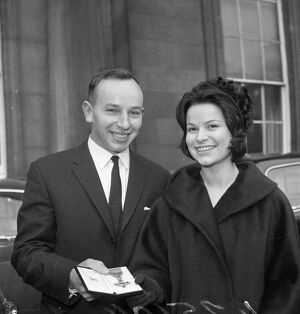John Surtees with Miss Patricia Burke outside Buckingham Palace after he collected
