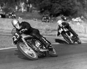 John Surtees Here pictured crouching around a corner on his way to win at Brands